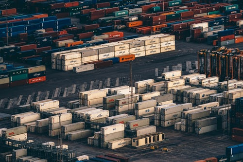 Birdseye view of shipping containers at a port that uses scissor lift platforms